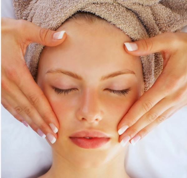 Portrait of a young girl having a massage at a spa resort.